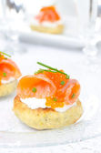 Appetizer - potato bun with salted salmon, red caviar — Stock Photo