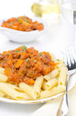 Penne pasta with sauce of beef, tomato and pumpkin close-up — Stock Photo