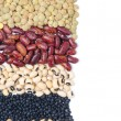 Stock Photo: Assorted cereals and legumes with space for text isolated
