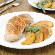 Baked chicken and saute quince with rosemary closeup — Stock Photo #25665889