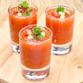 Cold tomato soup gazpacho in portion glasses — Stock Photo