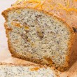 Orange cake with poppy seeds, dried apricots, walnuts and honey — Stock Photo