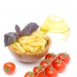 Penne pasta, fresh tomatoes, basil, olive oil isolated on white — Stock Photo #26303529