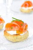 Appetizer - potato bun with salted salmon, red caviar — Stock Photo