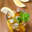 Glass of ice tea with lemon and mint — Stock Photo