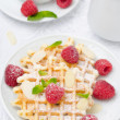 Waffles, fresh raspberries and tea for breakfast, top view — Stock Photo