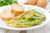 Omelette with asparagus, greens and toast, selective focus — Stock Photo