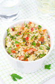 White bowl of salad with bulgur, zucchini, tomatoes and parsley — Stock Photo