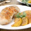 Baked chicken and saute quince with rosemary closeup — Stock Photo #27265253