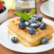 Belgian waffles with blueberries, coffee and fresh fruit — Stockfoto