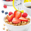 Granola with fresh berries, coffee and yellow alarm clock  — Stock Photo