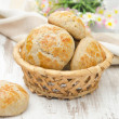 Homemade cottage cheese bread rolls in a basket — Stock Photo #27265659
