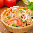 Постер, плакат: Italian salad panzanella with tomatoes onions and croutons
