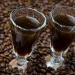 Two shot glasses of coffee liqueur, horizontal — Stock Photo