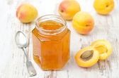 Apricot confiture in a glass jar and fresh apricots, horizontal — Stock Photo