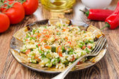 Salad with bulgur, zucchini, tomatoes and parsley — Stock Photo
