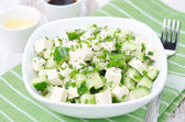 Salad with cucumber, tofu, chives and sesame seeds, horizontal — Stock fotografie