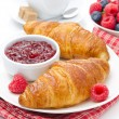 Delicious breakfast - fresh croissant with raspberry jam, coffee — Stock Photo #27425575