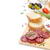 Antipasto - salami, bread, olives, tomatoes isolated on white — 图库照片