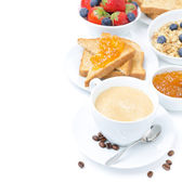 Cup of cappuccino, toast with orange jam, berries and muesli — Stock Photo