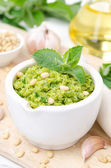 Pesto with green peas, mint and pine nuts close-up — Stock Photo
