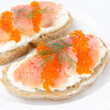 Sandwich with cream cheese, salted salmon and red caviar — Stock Photo