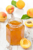 Apricot confiture in a glass jar — Stock Photo