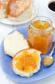 Sweet bun with apricot jam for breakfast — Stock Photo