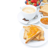Toast with orange jam, cup of cappuccino and fresh berries — Photo