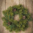 Christmas fir wreath on vintage wooden background — Stock Photo