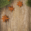 Christmas frame (spruce branches and star anise) on the old wood — Stock Photo #28121969