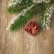 Christmas vintage wooden background (spruce branches and gift) — Foto Stock