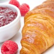 Delicious breakfast - fresh croissant, jam and raspberry — Stock Photo