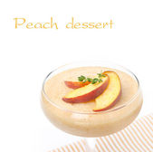 Peach souffle in glass, isolated on white, close-up — Stock Photo
