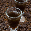 Coffee liqueur into a shot glass, selective focus — Stock Photo