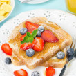 Crispy toast with honey, fresh berries, cup of coffee — Stock Photo