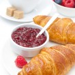 Delicious breakfast - fresh croissant with raspberry jam — Stock Photo