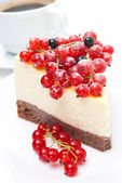 Close-up of piece of cheesecake with red and black currants — Stock Photo