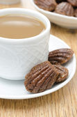 Madeleine cookies and a cup of coffee with milk — Stock Photo