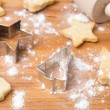 Stock Photo: Christmas cookies and baking dish on wooden board