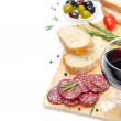 Stock Photo: Salami, ciabatta, olives and glass of wine on wooden board