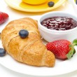 Breakfast with croissant, jam, fresh berries and coffee — Stock Photo
