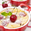 Stock Photo: Casserole (clafoutis) with cherry in ramekin, close-up