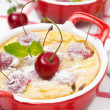 Casserole (clafoutis) with cherry in the ramekin, close-up — Stock Photo