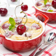 Stock Photo: Casserole (clafoutis) with cherry in ramekin, horizontal