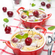 Clafoutis with cherries in ramekin — Stock Photo