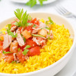 Saffron rice with tuna, tomatoes, peppers and greens close-up — Stock Photo