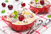 Casserole (clafoutis) with cherry in the ramekin, horizontal — Stock Photo