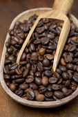 Close-up of a wooden bowl with coffee beans — Stock Photo