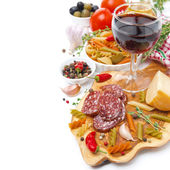 Italian food - cheese, sausage, pasta, spices and wine isolated — Stock Photo